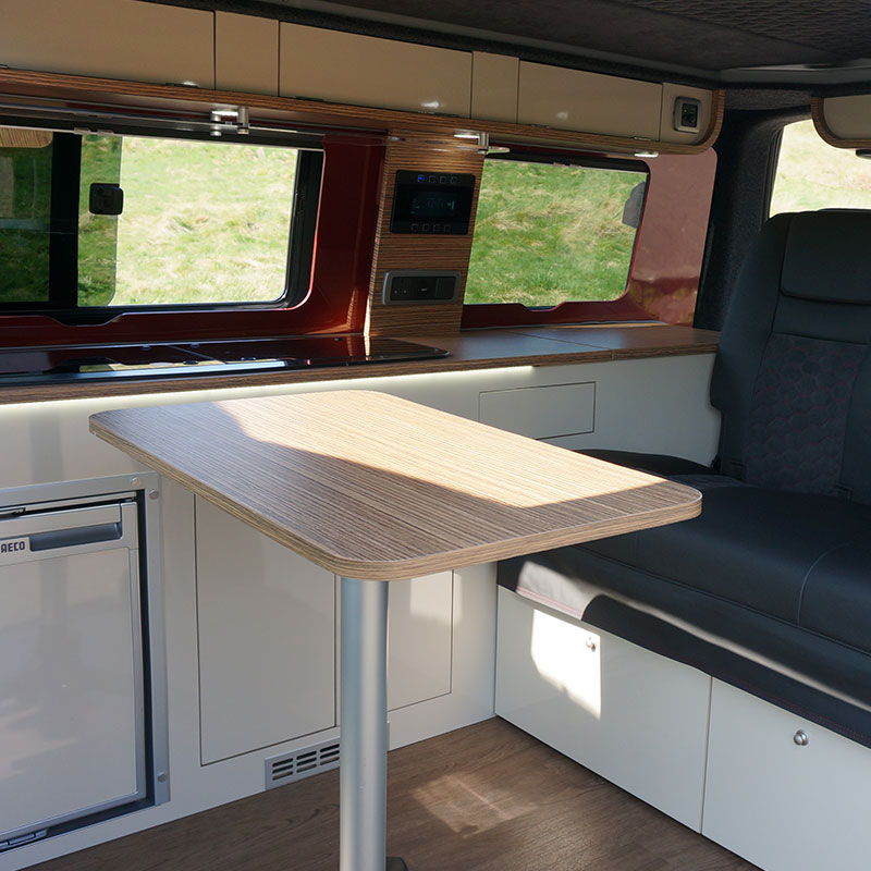 Exterior image of Bonnie the Camper van with doors open and bed expanded